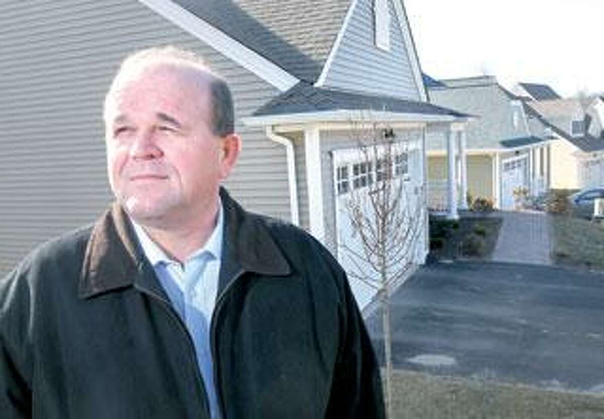 Harry Roscoe stands in front of his home in Chatfield Farms in Beacon Falls. When he bought the home about a year ago, he took advantage of incentives the home builder offered to help him sell his old house. (Arnold Gold/Register)
