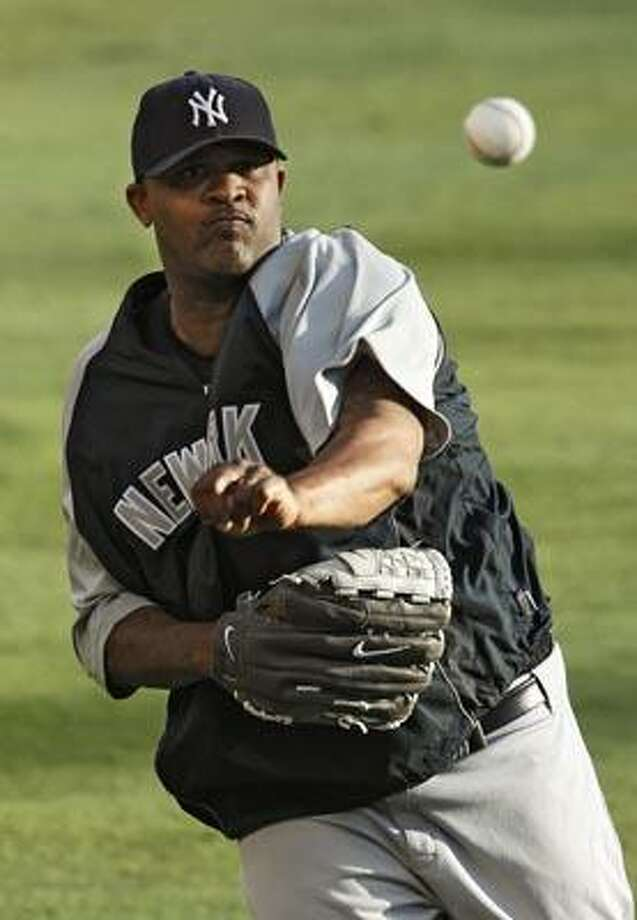 New York Yankees starting pitcher CC Sabathia warms up during practice for baseball's American League Championship Series, Thursday, Oct. 14, 2010, in Arlington, Texas. The Yankees are to play the Texas Rangers in Game 1 on Friday night. (AP Photo/Mark Humphrey) Photo: AP / AP