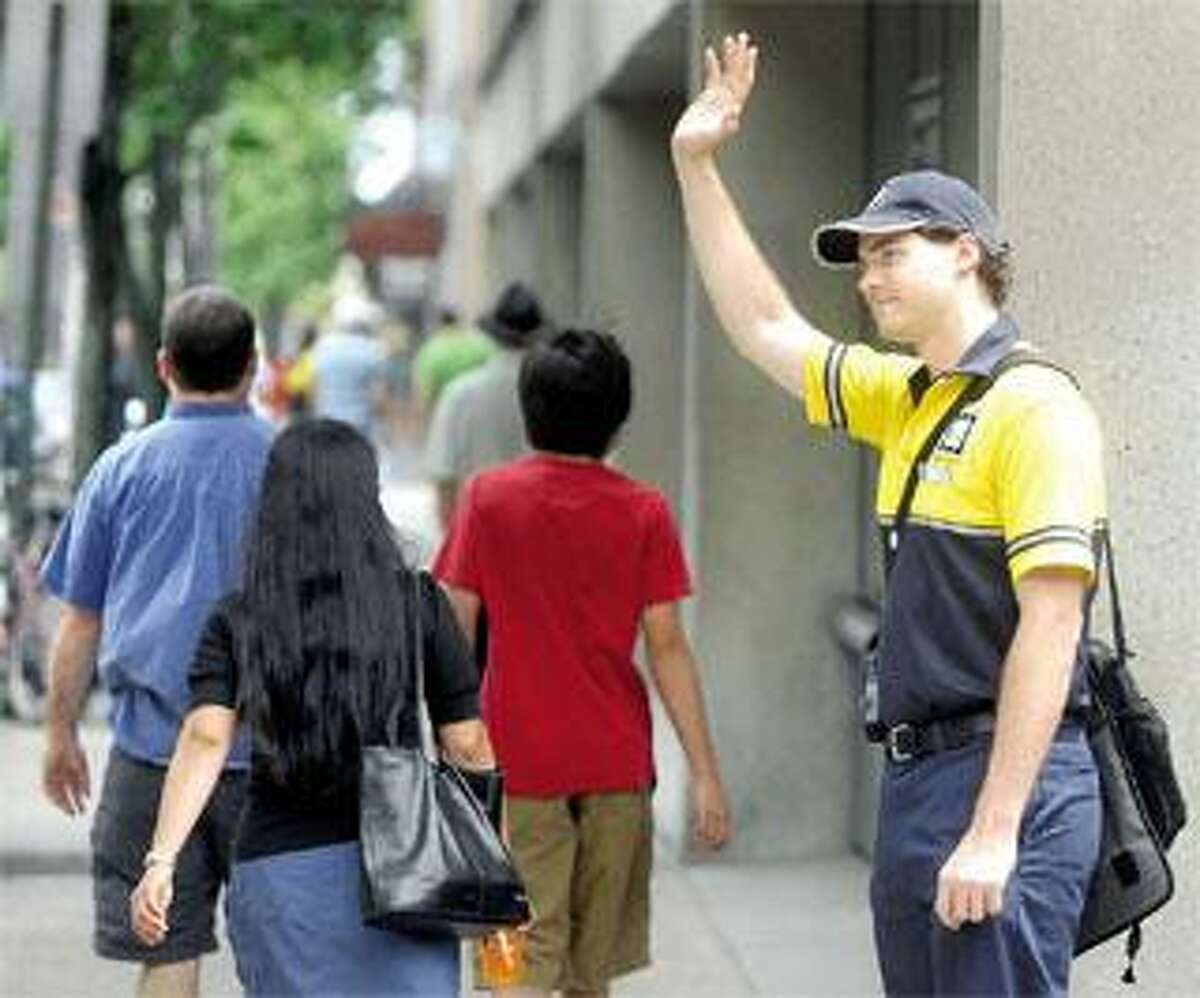 One of Chapel Street's bright spots is downtown ambassador Greg Ledovsky. (Arnold Gold/Register photos)
