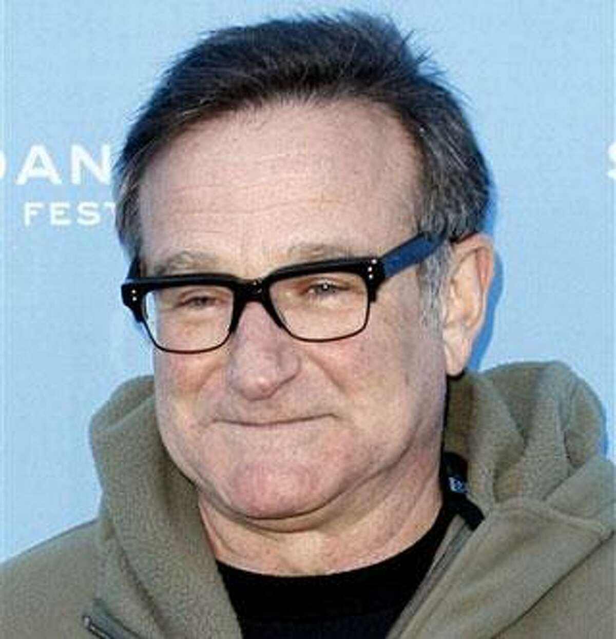 """In this Jan. 18, 2009 file photo, Robin Williams arrives at the premiere of """"World's Greatest Dad"""" at the Sundance Film Festival in Park City, Utah. (AP Photo/Matt Sayles, File)"""