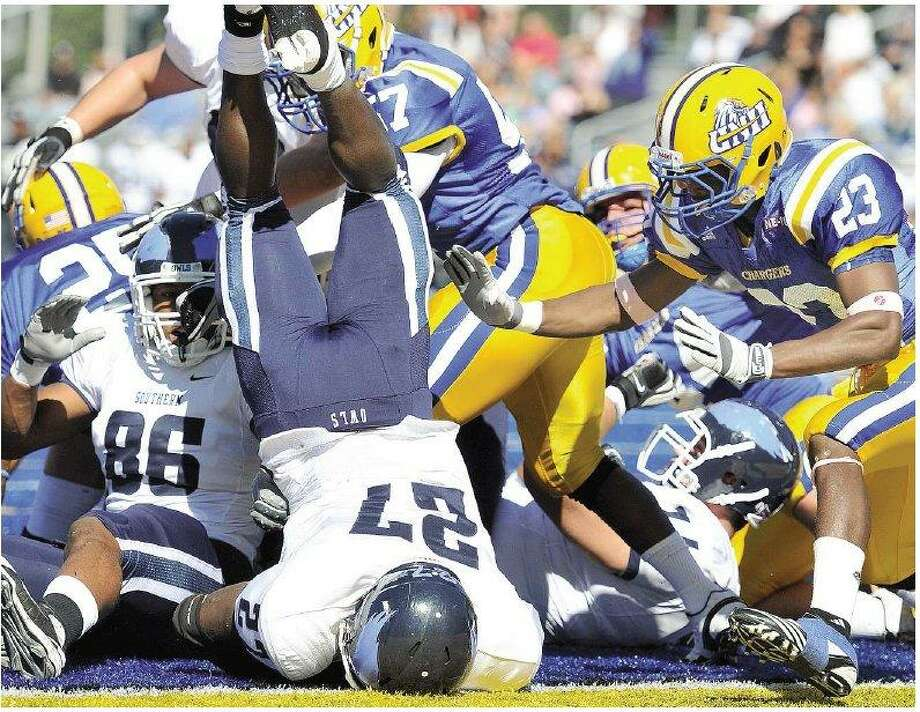 Southern Connecticut State running back Rashad Slowley got over the pile but came up short of the end zone in the first quarter Saturday. New Haven stopped Southern on four straight plays from the 1-yard line for a goal-line stand on the Owls' first drive of the game and went on to win the game 23-22. (Peter Casolino/Register)