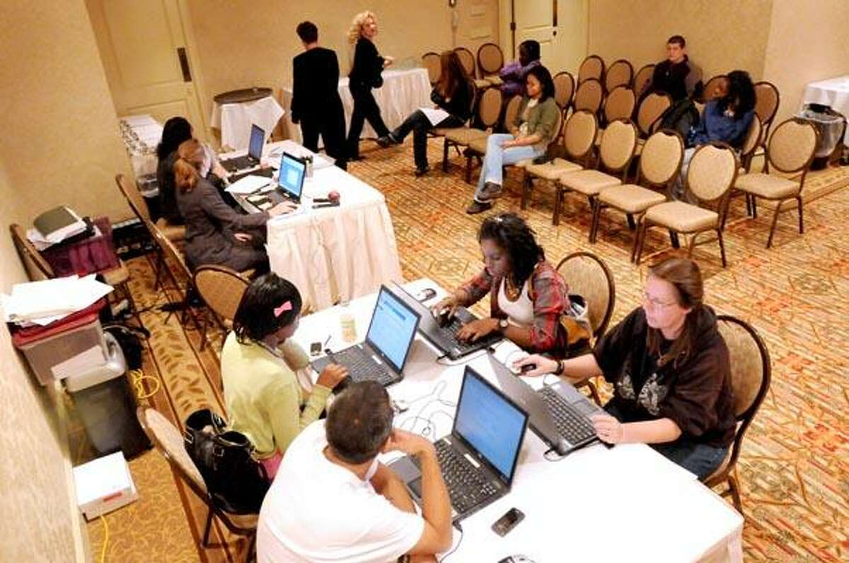 Prospective Big Y employees filling out applications and waiting for interviews Friday afternoon at the Omni New Haven Hotel at Yale. (Peter Hvizdak/Register)