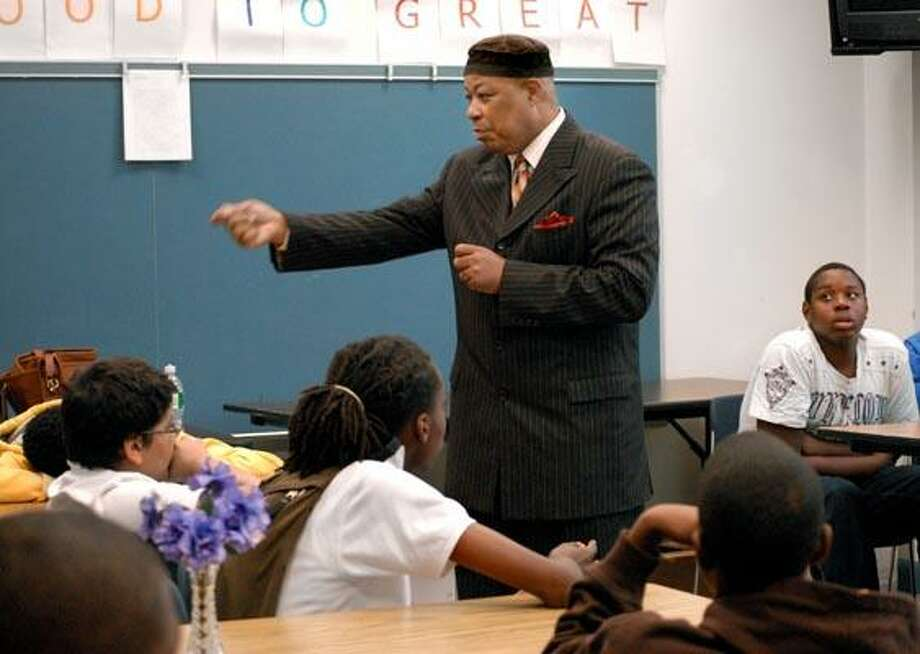 Civil rights leader and educator, Clifton Graves, speaks to a group of black male students at Lincoln Bassett School in New Haven. (Melanie Stengel/Register)