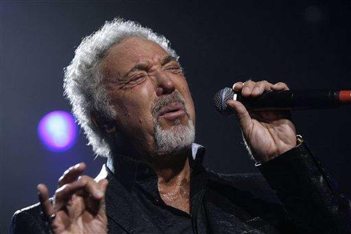 FILE - In this Sept. 24, 2009 file photo, singer Tom Jones performs at the Guinness 250th Anniversary Celebration at the Guinness storehouse in Dublin, Ireland. (AP Photo/Joel Ryan)