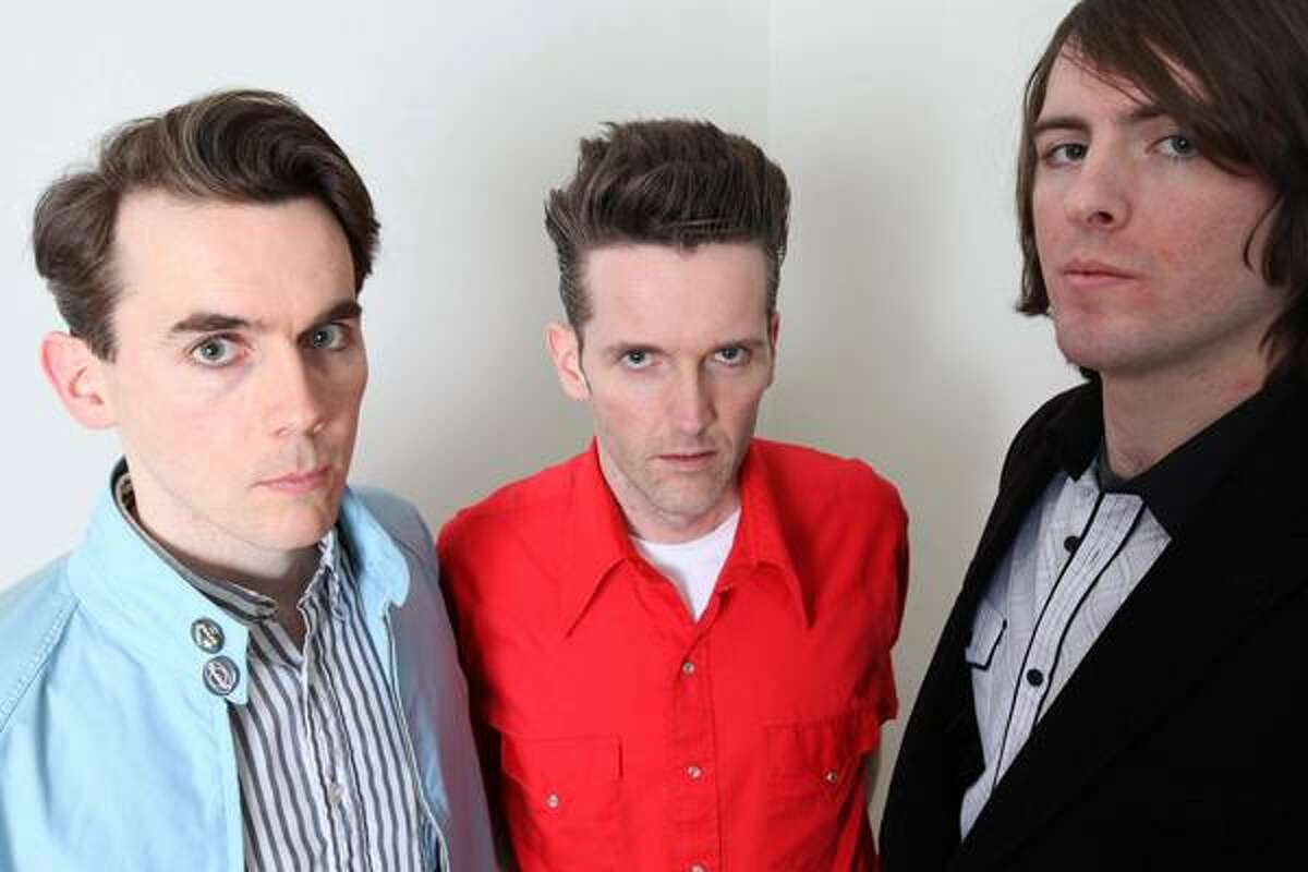 THE BOONDOCK SAFES: Power pop's best kept secret are a gang of hard rocking Irish brothers with hearts of conviction. Chicago's The Safes; Patrick O'Malley, Frankie O'Malley, and Patrick Mangan. Photo by Andrew Ballantyne.