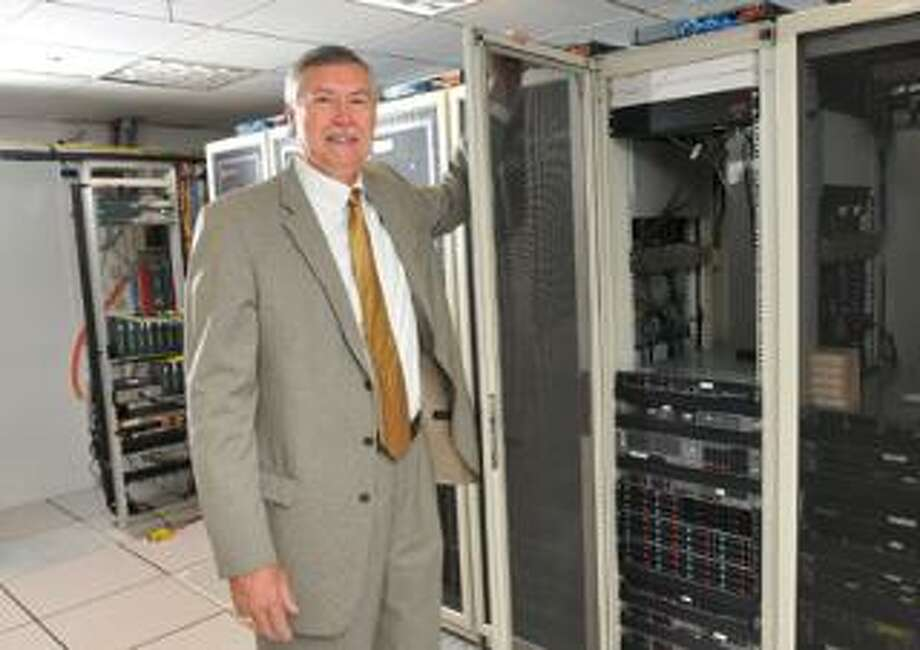 Peter Casolino/Register photos Dale Bruckhart, vice president of marketing at Digital BackOffice, shows off the company's data center in Wilton.