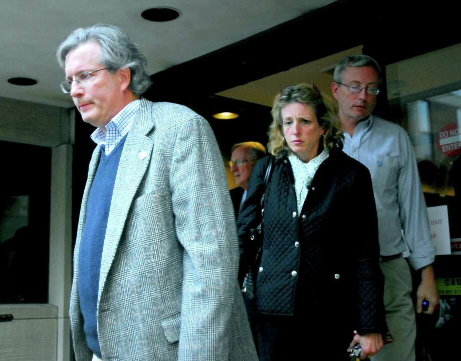 Dr. William Petit, Jr. (left), walks out of Superior Court in New Haven followed by his sister, Johanna Chapman (center), and brother, Glen Petit (right), while the jury deliberates on 10/4/2010.Photo by Arnold Gold   AG0386F