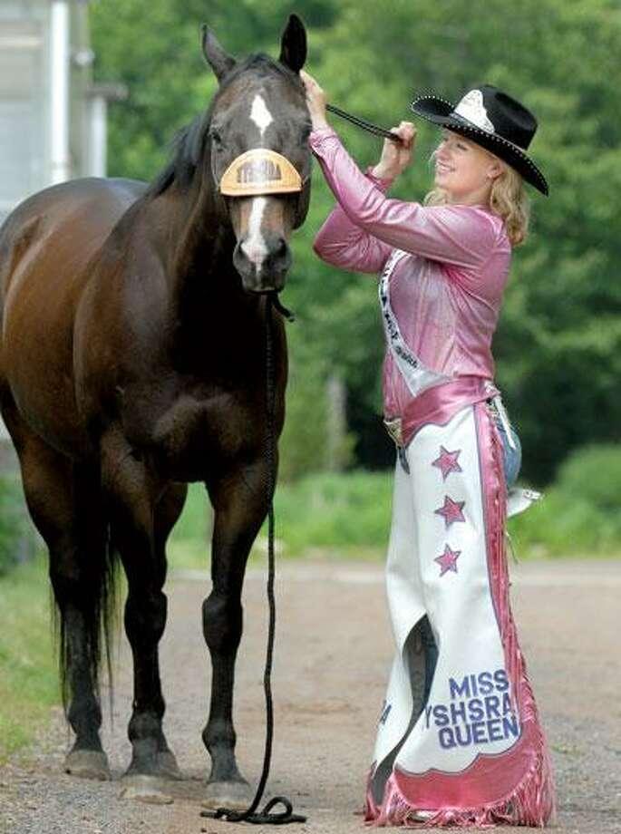 Christensen prepares her horse, H.C. They will be competing in Wyoming next month. (Mara Lavitt/Register)