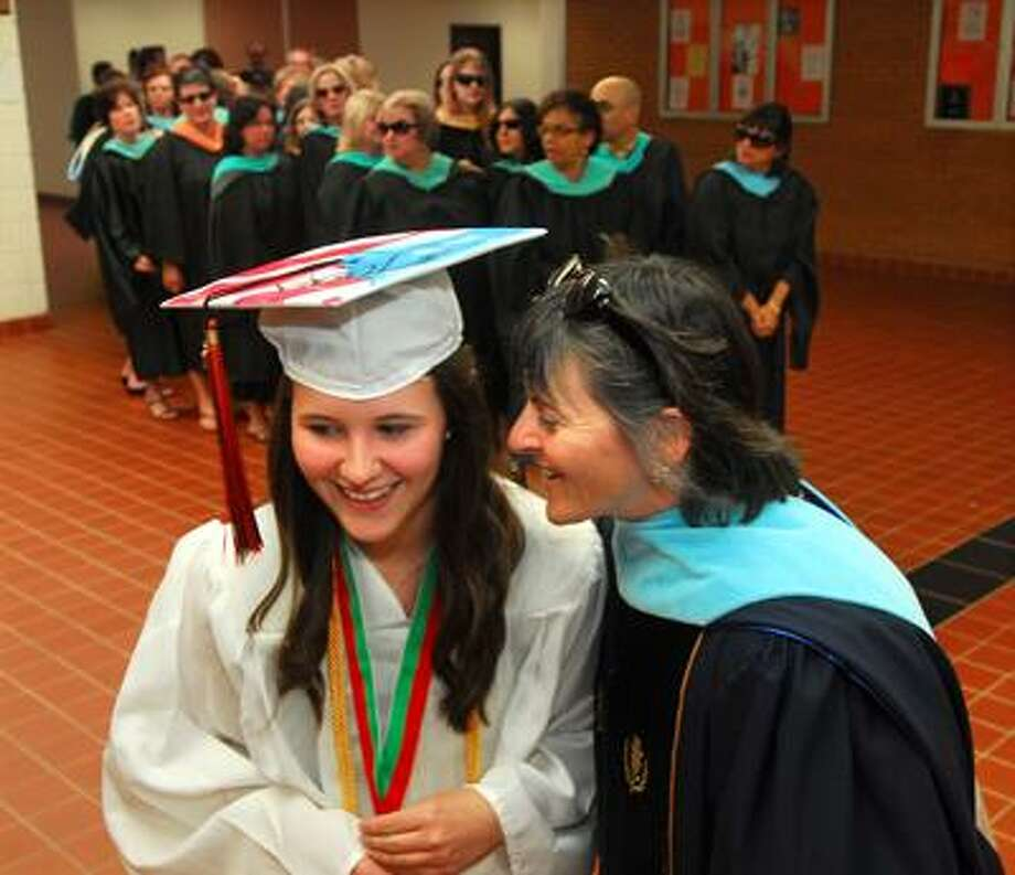 Shelton High School headmaster Beth A. Smith, right, has a word with graduating senior Sarah Tagg before commencement exercises Friday evening. (Brad Horrigan/Register)