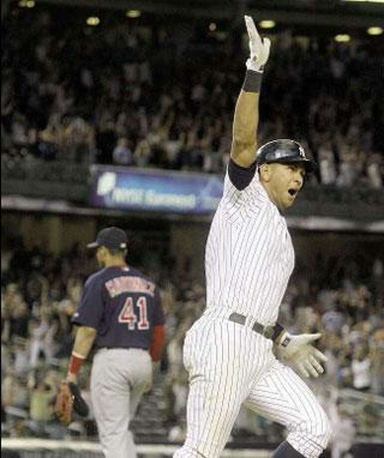 New York Yankees' Alex Rodriguez reacts after hitting a game winning two-run home run during the 15th inning of the Yankees 2-0 win over the Red Sox. (Associated Press)