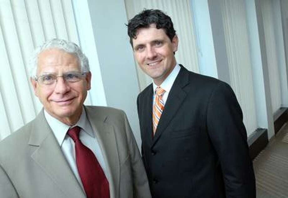 Bob Kreitler (left) and his son, Charlie Kreitler, of Kreitler Financial are photographed in their New Haven office on 6/3/2010. Photo by Arnold Gold