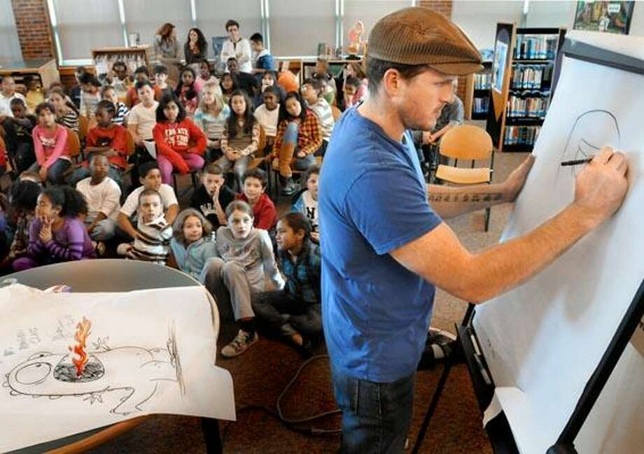 HAMDEN-Animation artist, Mark Salisbury, makes  deawings for the fourth grade classes at Wintergreen  Magnet School. The classes watched the new  animated Nickelodeon show, Bubble Guppies, which Salisbury draws.    Melanie Stengel/Register11/22/10
