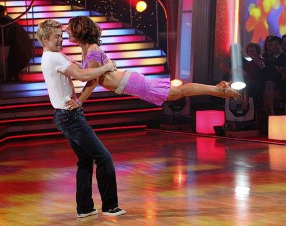 """In this publicity image released by ABC, Jennifer Grey, right, and her partner Derek Hough perform on the celebrity dance competition series, """"Dancing with the Stars,"""" on Monday, Nov. 22, 2010 in Los Angeles. (AP Photo/ABC, Adam Larkey) Photo: AP / © 2010 American Broadcasting Companies, Inc. All rights reserved."""