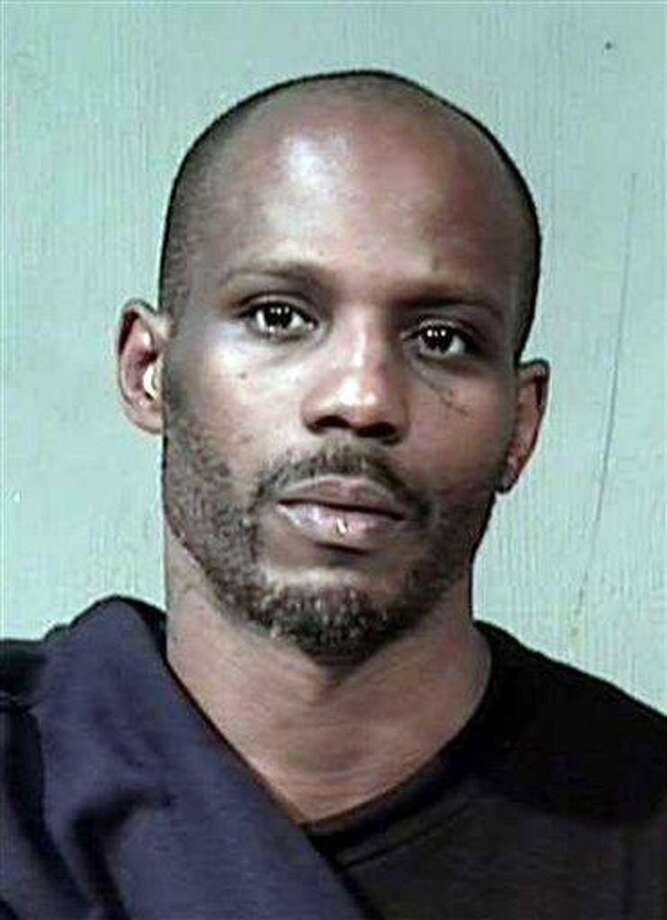 This is a booking photograph of rapper DMX, provided by the Maricopa County Sheriff's Office on Friday, Nov. 19, 2010, in Phoenix, after the latest arrest of the rapper.  Maricopa County authorities say rapper DMX has been arrested in Phoenix for allegedly violating his probation by using drugs.  DMX, whose real name is Earl Simmons, has been arrested twice for violating probation for 2009 felony convictions for cruelty to animals, theft and two drug counts.  The 39-year-old was arrested by Maricopa County probation officers Thursday evening and is being held without bond in the county jail. (AP Photo/Maricopa County Sheriff's Office) Photo: AP / Maricopa County Sheriff's Office