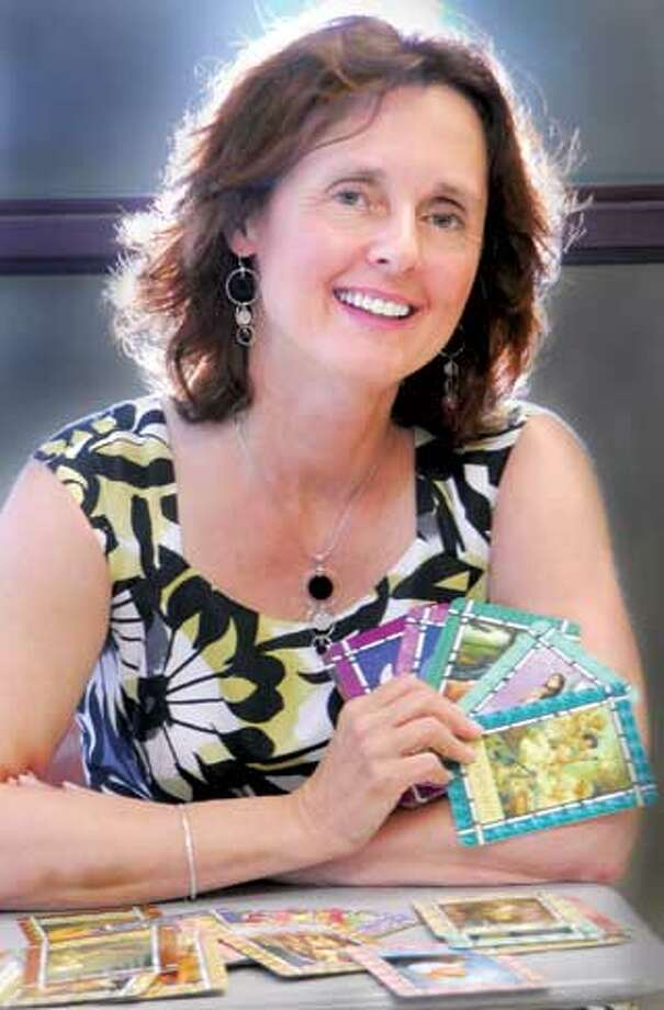 Integrated-energy therapist Carla Augstyn of Madison introduces Healing with the Angels cards by Doreen Virtue in her classes. (Melanie Stengel/Register)