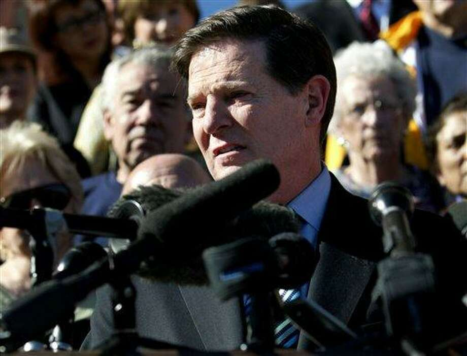 In this Jan. 7, 2006 file photo, Rep. Tom DeLay speaks during a news conference after announcing his decision to abandon his bid to remain as House majority leader in Sugar Land, Texas. (AP Photo/David J. Phillip, File) Photo: AP / AP