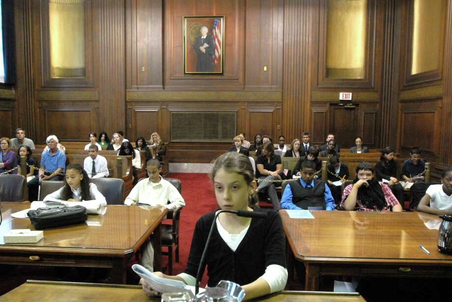 6/9/10 1MockML0607John C. Daniels School (New Haven)  fifth-grader Hannah Melchinger age 11 of New Haven as a lawyer in the mock trial held at Federal Court in New Haven. Photo by Mara Lavitt