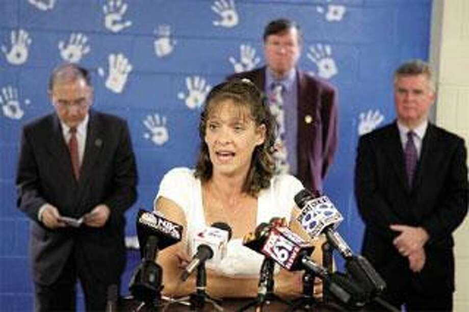 Stacy Tattersall of Bristol, whose son is cared for at High Meadows, addresses a news conference on the facility's imminent closing. (Peter Casolino/Register)