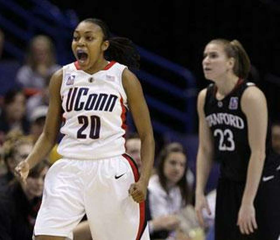 Connecticut's Renee Montgomery (20) celebrates in the second half against Stanford in a semifinal of the NCAA women's college basketball tournament Final Four on Sunday, April 5, 2009, in St. Louis. (AP Photo/Lynne Sladky)