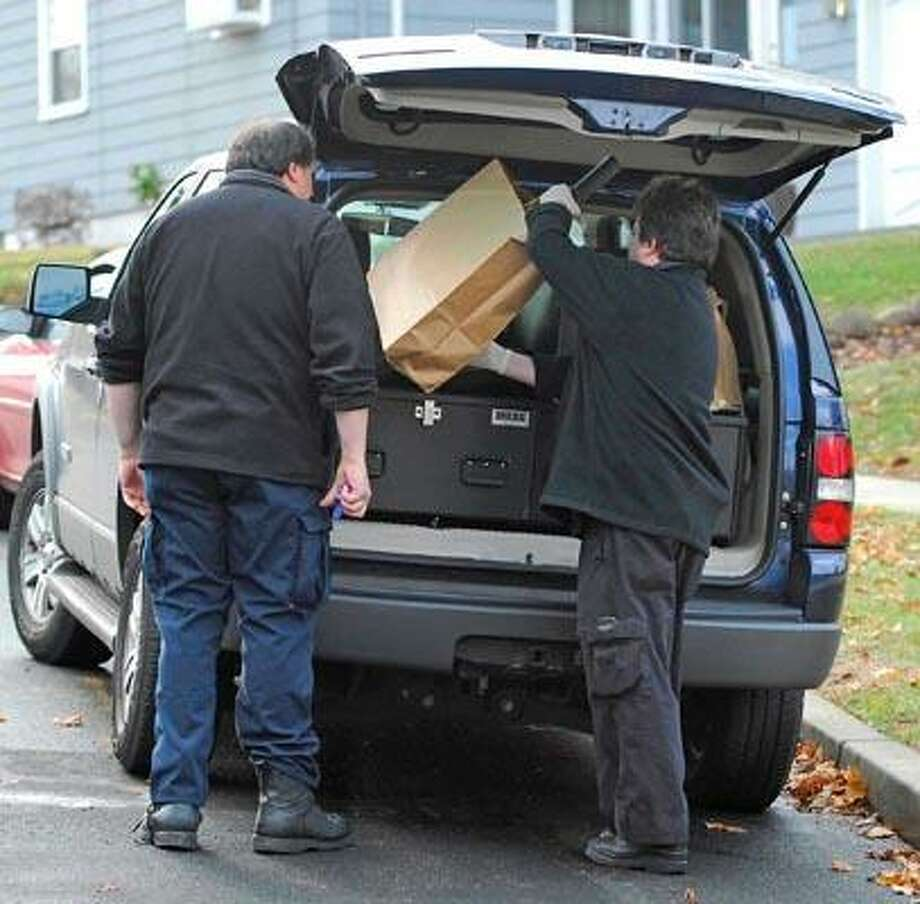 New Haven--Investigators load a bag into their van that came out of 15 Westerleigh Rd Monday.  The house was the scene of a fatal stabbing early Sunday morning.  Photo by Brad Horrigan/New Haven Register-11.22.10.  BH0719-101122