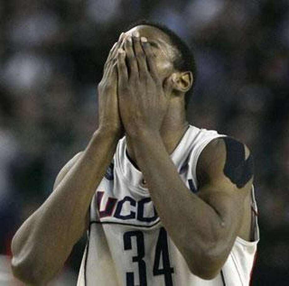 Connecticut's Hasheem Thabeet reacts during a men's NCAA Final Four semifinal college basketball game, Saturday, April 4, 2009, in Detroit. (AP Photo/Carlos Osorio)