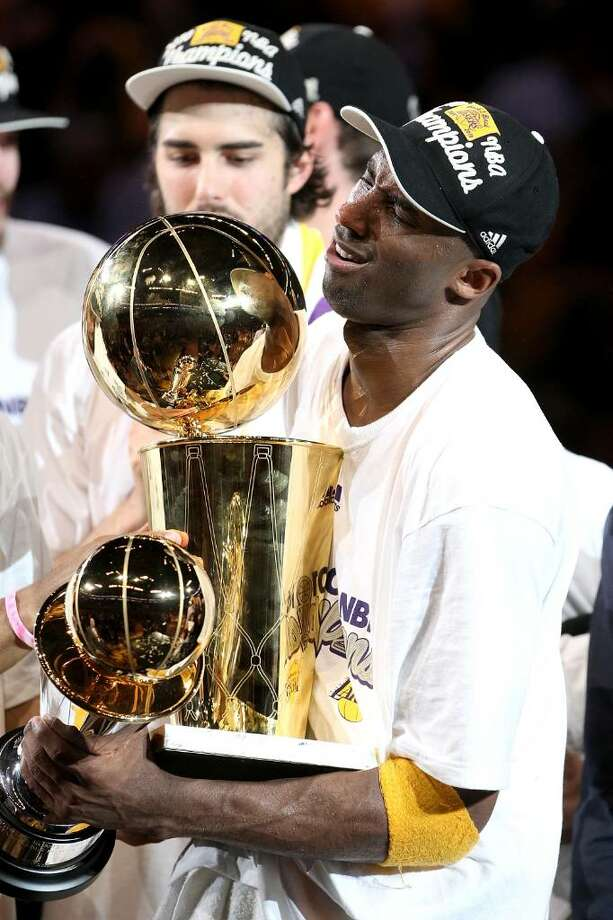 LOS ANGELES, CA - JUNE 17:  Kobe Bryant #24 of the Los Angeles Lakers struggles to hold both the Larry O'Brien trophy and the MVP trophy after the Lakers defeated the Boston Celtics in Game Seven of the 2010 NBA Finals at Staples Center on June 17, 2010 in Los Angeles, California.  NOTE TO USER: User expressly acknowledges and agrees that, by downloading and/or using this Photograph, user is consenting to the terms and conditions of the Getty Images License Agreement.  (Photo by Christian Petersen/Getty Images) *** Local Caption *** Kobe Bryant Photo: Christian Petersen, Getty Images / 2010 Getty Images