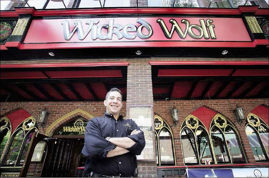 Peter Casolino/Register General Manager Stephen Deierlein stands in front of Wicked Wolf Tavern at 144 Temple St., formerly Playwright Irish Pub.