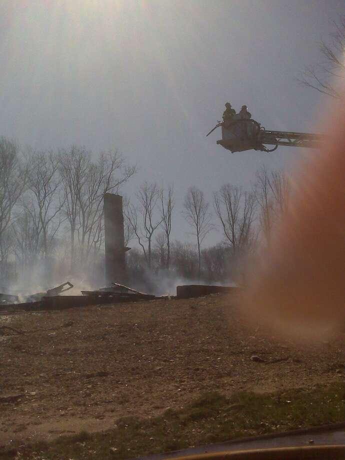 Firefighters at scene of Guilford blaze. (Susan Misur/Register)