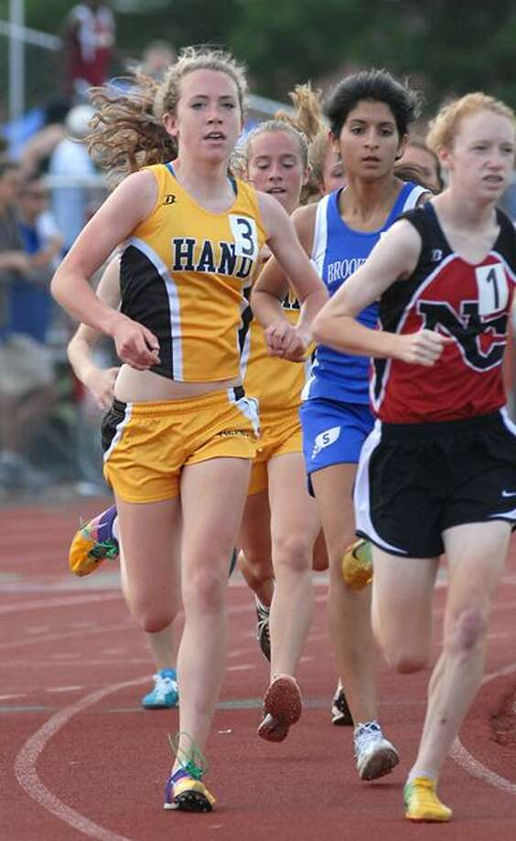 Cas100604  06/04/10Manchester-- Hand's Sarah Cotton, left, prepares to make her move during the 1600. She won the race. Photos -Peter Casolino/New Haven Register *