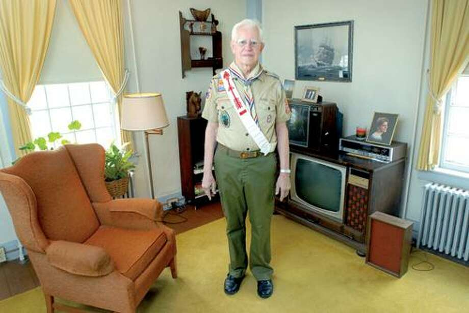 Gay former Boy Scout leader David Knapp is photographed wearing his old National Jamboree uniform at his home in Guilford on 3/26/2009. Photo by Arnold Gold
