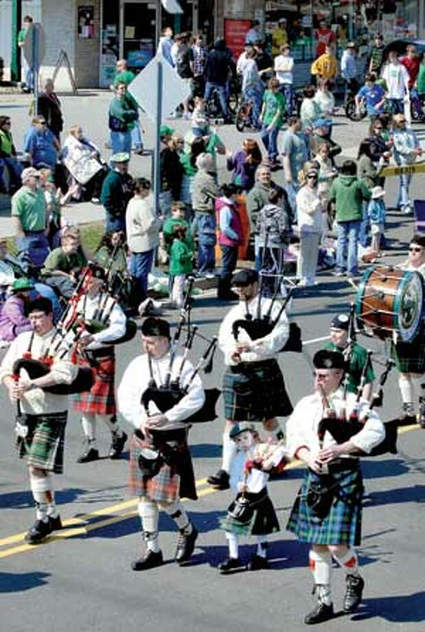 The Irish Heritage Society Pipes & Drums perform in the St. Patrick's Day Parade in Milford. (Arnold Gold/Register)