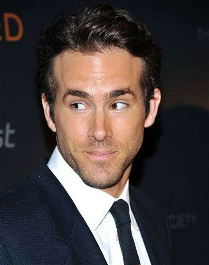 FILE - In this Sept. 16, 2010 photo shows Actor Ryan Reynolds at a special screening of 'Buried' hosted by the Cinema Society at the Tribeca Grand Hotel  in New York. (AP Photo/Evan Agostini, File) Photo: ASSOCIATED PRESS / AGOEV