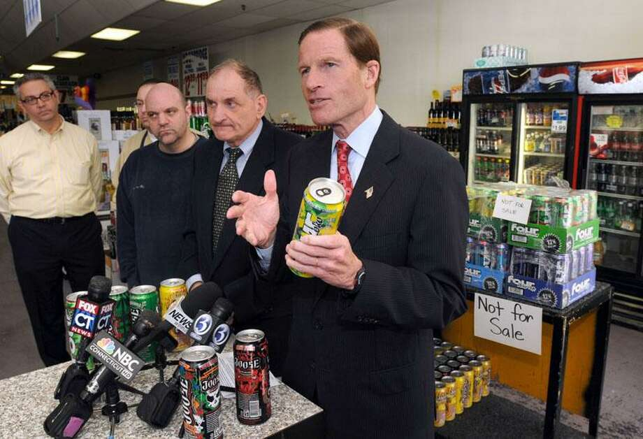 Attorney General Richard Blumenthal right called for a halt to alcoholic energy drink sales at a press conference at Sav-Rite Liquors in North Haven. With Blumenthal are left to right: North Haven Police Commissioner Larry Lazaroff, and Sav-Rite owners Michael, Gregory and Al Jannotta. Photo by Mara Lavitt/New Haven Register11/17/10