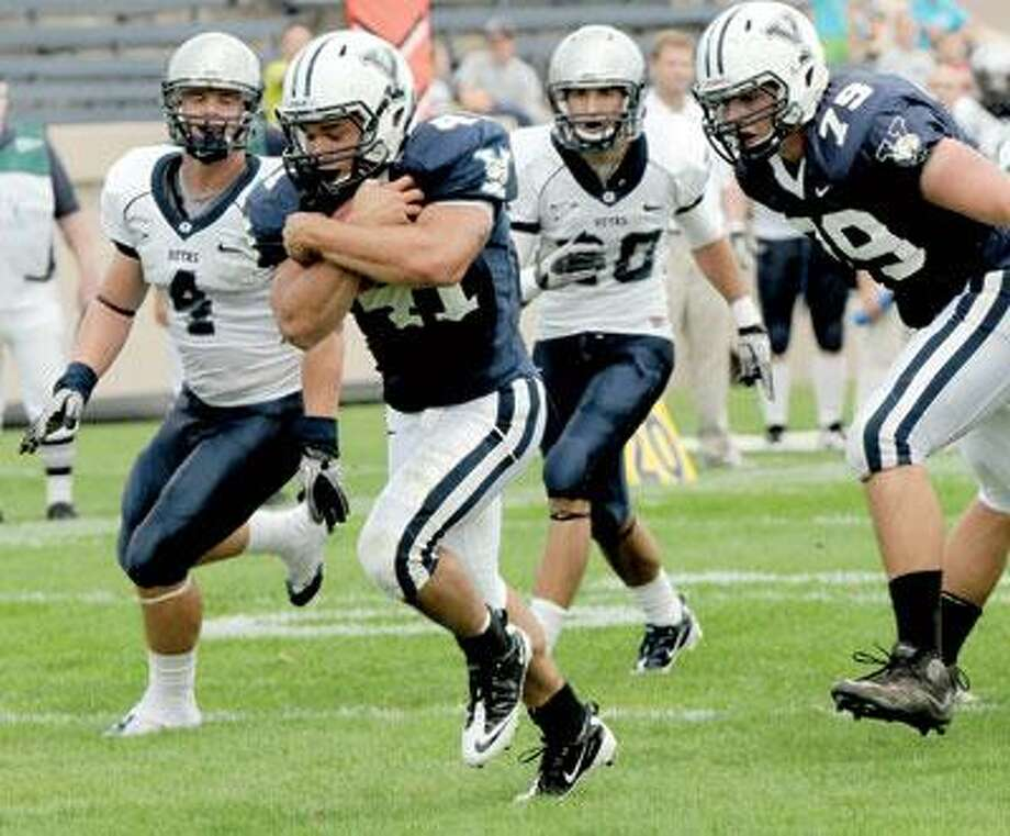 Yale running back Alex Thomas scores a touchdown against Georgetown during third quarter football action Saturday at Yale Bowl. (Peter Hvizdak/Register)