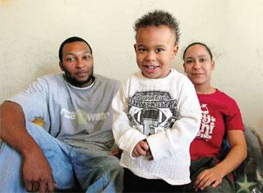 Curtis Carr and Rachel Harris, with their son, Zion Carr-Harris, are helped by a state-funded program that may be eliminated due to budget cuts. (Peter Casolino/Register)