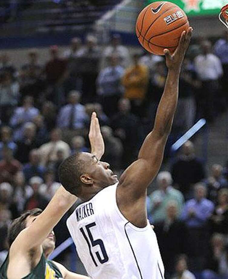 Connecticut's Kemba Walker, right, drives past Vermont's Evan Fjeld during the first half of an NCAA college basketball game in Hartford, Conn., on Wednesday, Nov. 17, 2010. (AP Photo/Fred Beckham)