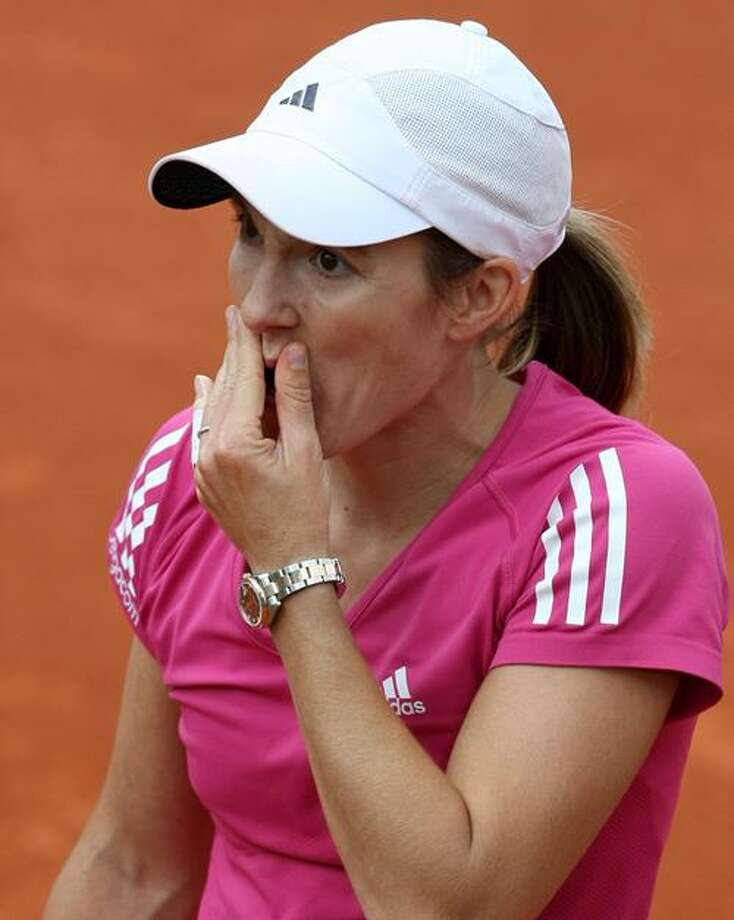 Justine Henin reacts after being defeated by Samantha Stosur during their fourth-round match at the French Open Monday at the Roland Garros stadium in Paris. (Associated Press) Photo: AP / AP