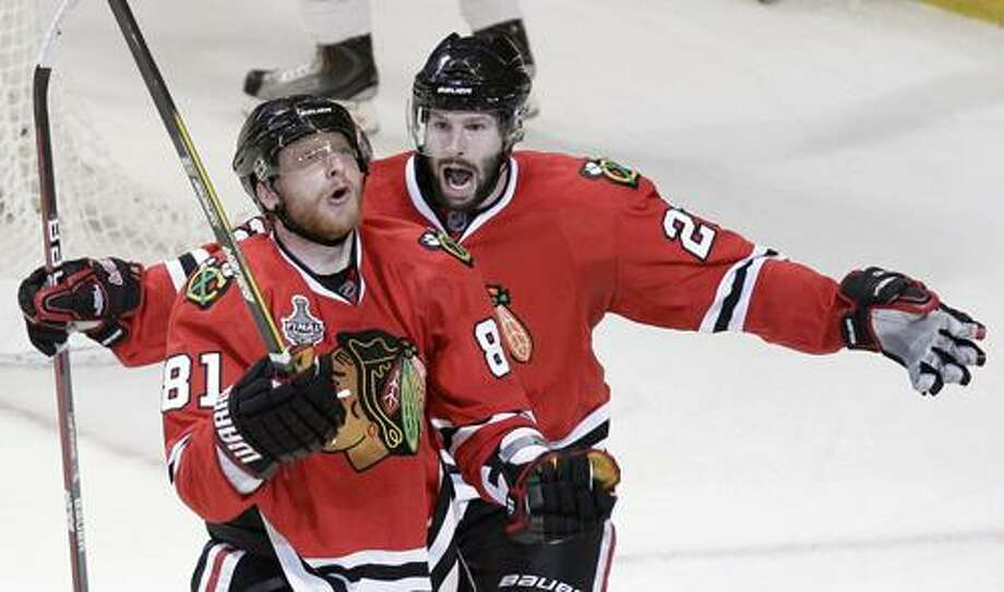 Right wing Marian Hossa (81) celebrates with Troy Brouwer after Hossa's goal in Chicago's 2-1 win over Philadelphia Monday in Game 2 of Stanley Cup finals. The Blackhawks have a 2-0 series lead. (Associated Press) Photo: AP / AP