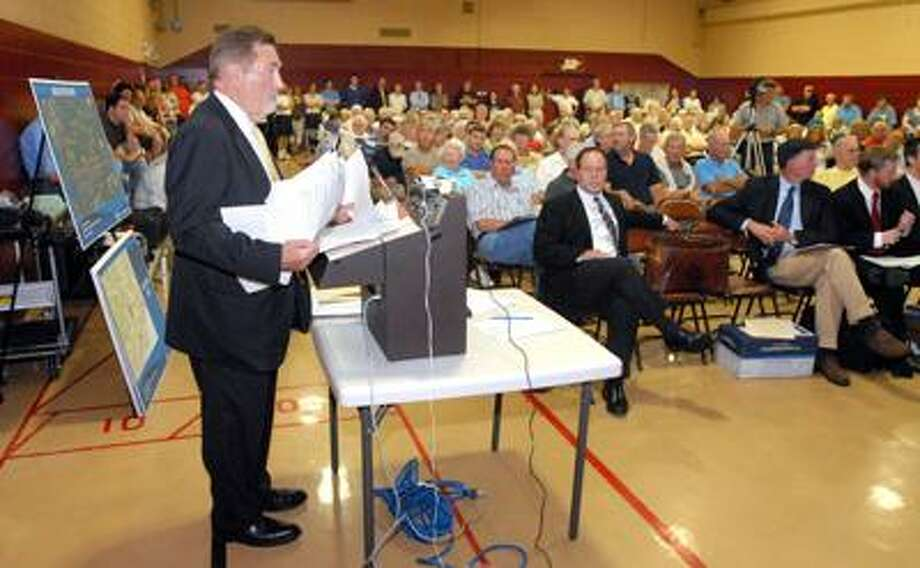 Robert Berchem, a lawyer for the Hubbell Inc., makes his presentation on the company's proposed property development, during a Town Plan and Zoning Commission public hearing Tuesday night at High Plains Community Center in Orange. (Mara Lavitt/Register)