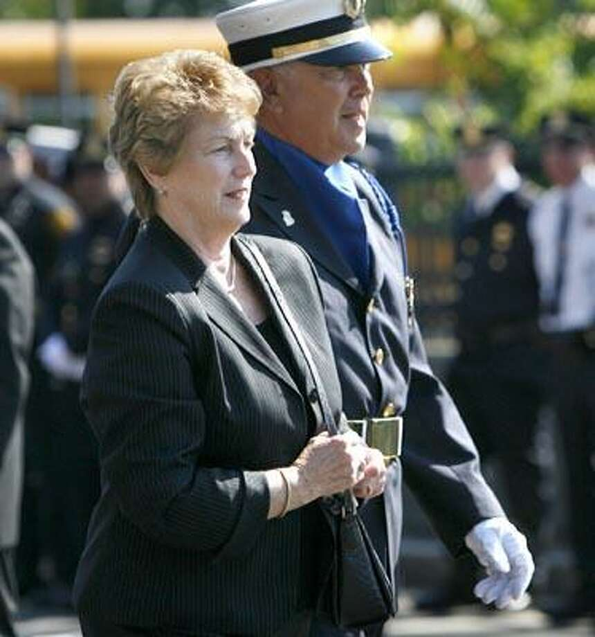 Governor M. Jodi Rell attends  the funeral of  Bridgeport firefighter Lt. Steven Velasquez on Friday, July 30, 2010 in Bridgeport, Conn.   Funerals are being held in Bridgeport  for city firefighters Steven Velasquez and Michel Baik.  The two men died during a house fire last Saturday.  (AP Photo) Photo: AP / Hartford Courant