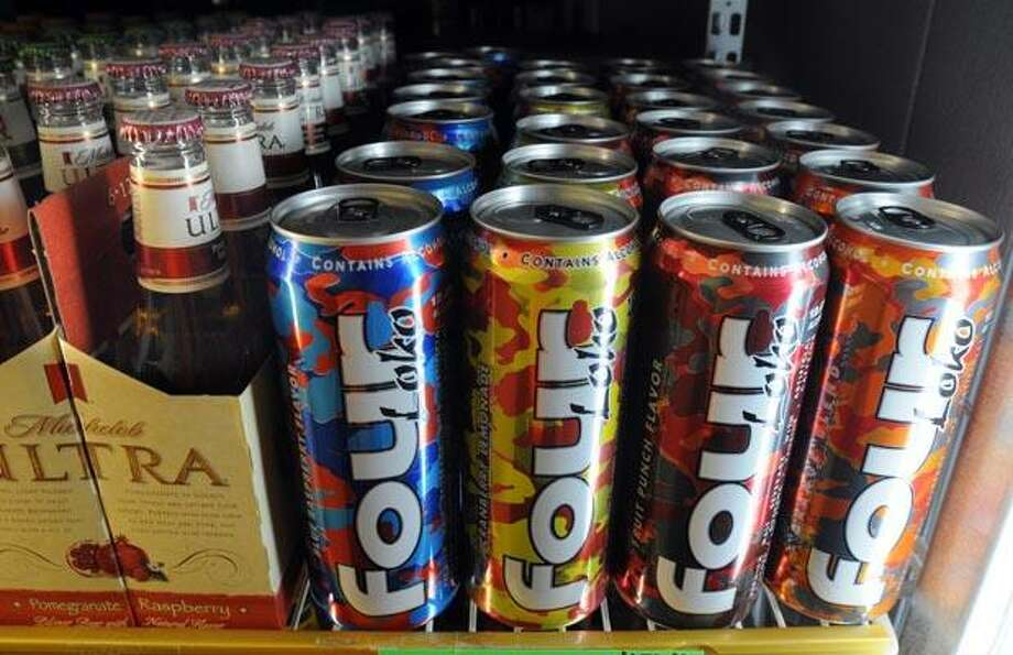 North Haven--At Sav-Rite Liquors in North Haven, cans of Four Loko line a refrigerator case. Photo by Mara Lavitt/New Haven Register  11/11/10