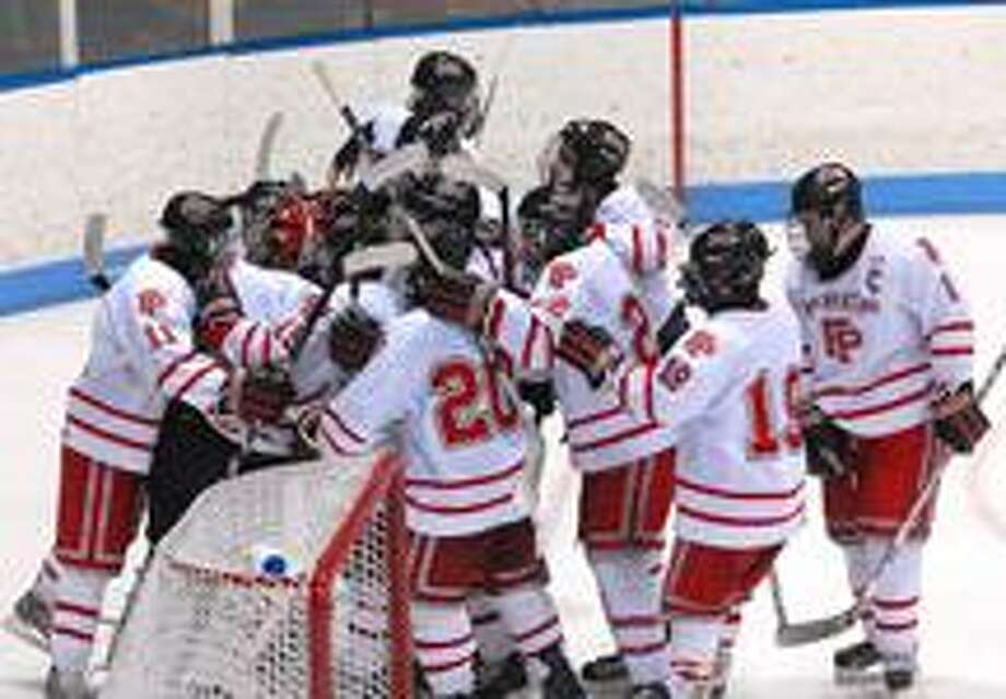 Fairfield Prep celebrates their win over New Canaan.  (Peter Casolino/Register)