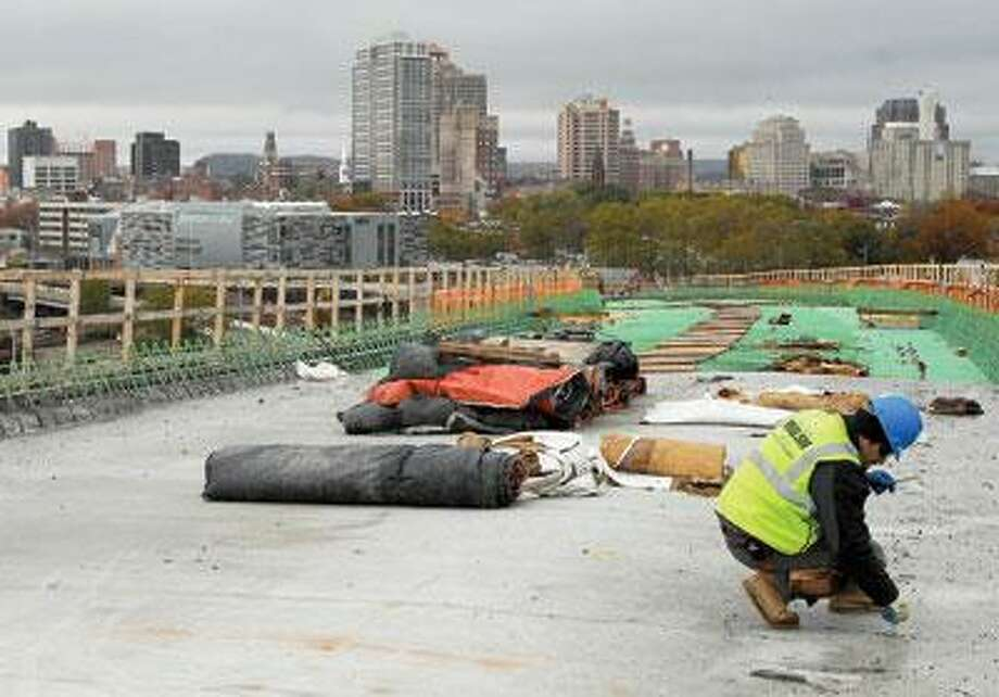 """Workers build the """"flyover"""" bridge that will take traffic from I-95 into downtown New Haven. (Brad Horrigan/Register)"""