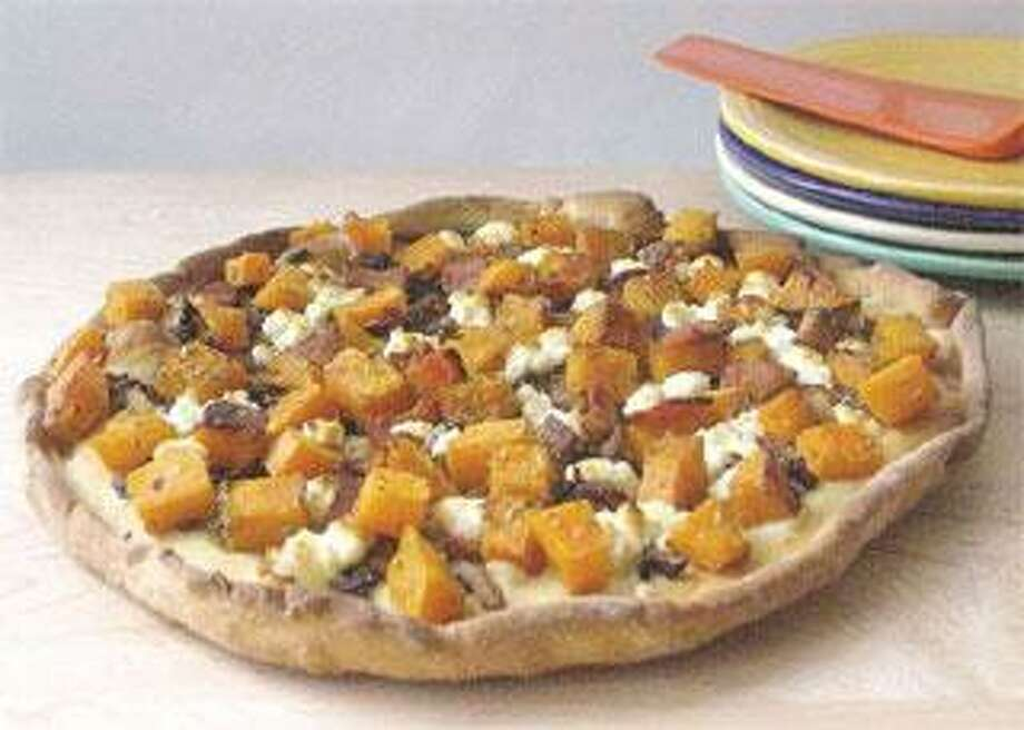Rustic Pizzas With Butternut Squash, Goat Cheese and Bacon. (Betty Rosbottom/Tribune Media Service)