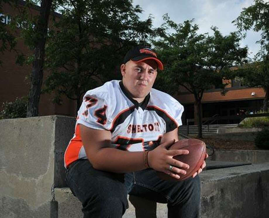 """Stefano Sanzo, a Shelton High Senior football player will have to pay $400 to play varsity football this year. Sanzo says he will probably pay most of the fee himself. """"Im the one playing football."""" said Sanzo. (Peter Casolino/Register)"""