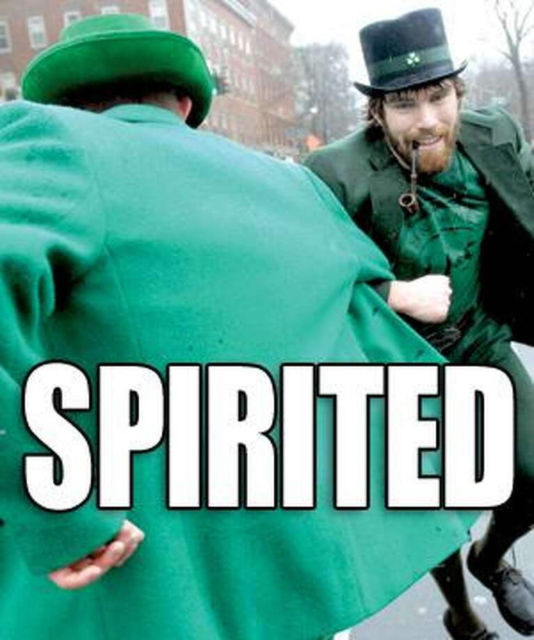 Ryan Crowley (left) of New Haven dances with his brother, Kevin (right), of Milford on Chapel St. during the annual St. Patrick's Day Parade in New Haven on 3/14/2010.Photo by Arnold Gold   AG0355F