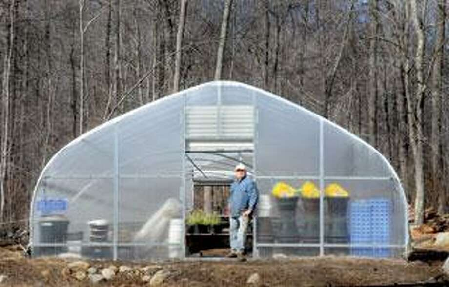 Bill Skokol of HiddenBrook Gardens, supports a bill that would let area farmers sell acidified foods such as salsa, chutney and pickles, at their farms.       (Melanie Stengel/Register)