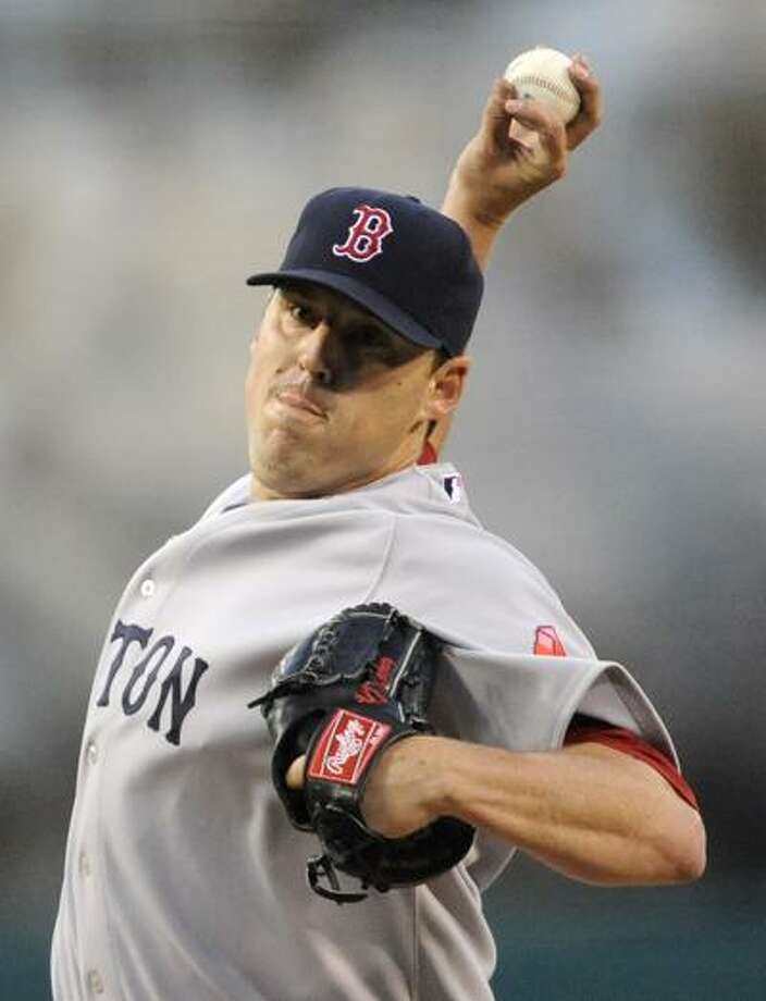 Red Sox starter John Lackey pitches in the first inning of Boston's game against the Angels on Tuesday night in Anaheim, Calif. (Associated Press/Gus Ruelas) Photo: AP / FR157633 AP