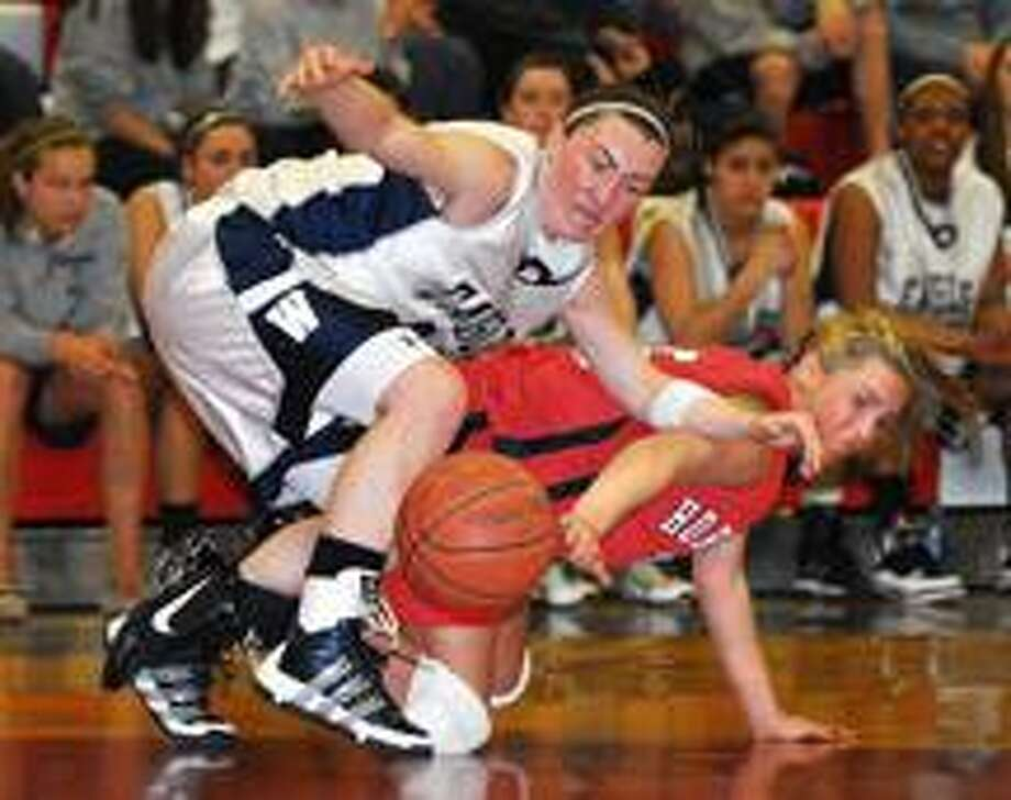 Branford's Courtney Schissler, bottom, and Weathersfield's Abbigail Corning battle for a loose ball on Weathersfield territory during the second period.  (Peter Casolino/Register)