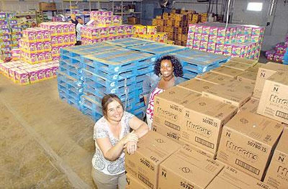 Joanne Goldblum left, president and founder of The Diaper Bank, with program director Kym Hunter in the new, larger warehouse space in North Haven. (Mara Lavitt/Register)